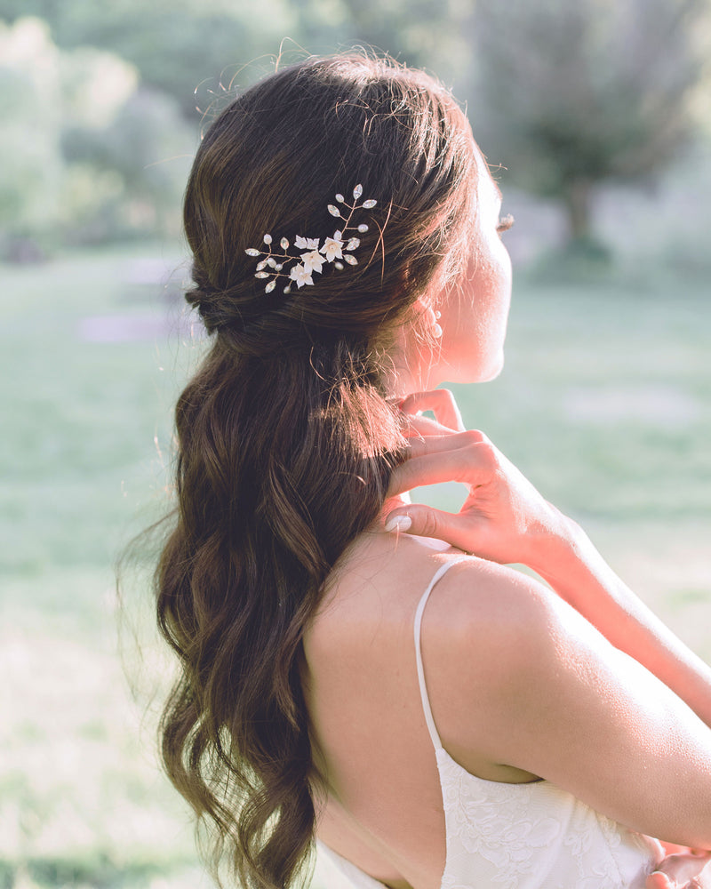 Model wearing Belle Fleur bridal hair pins with swarovski crystals and freshwater pearls with a half updo