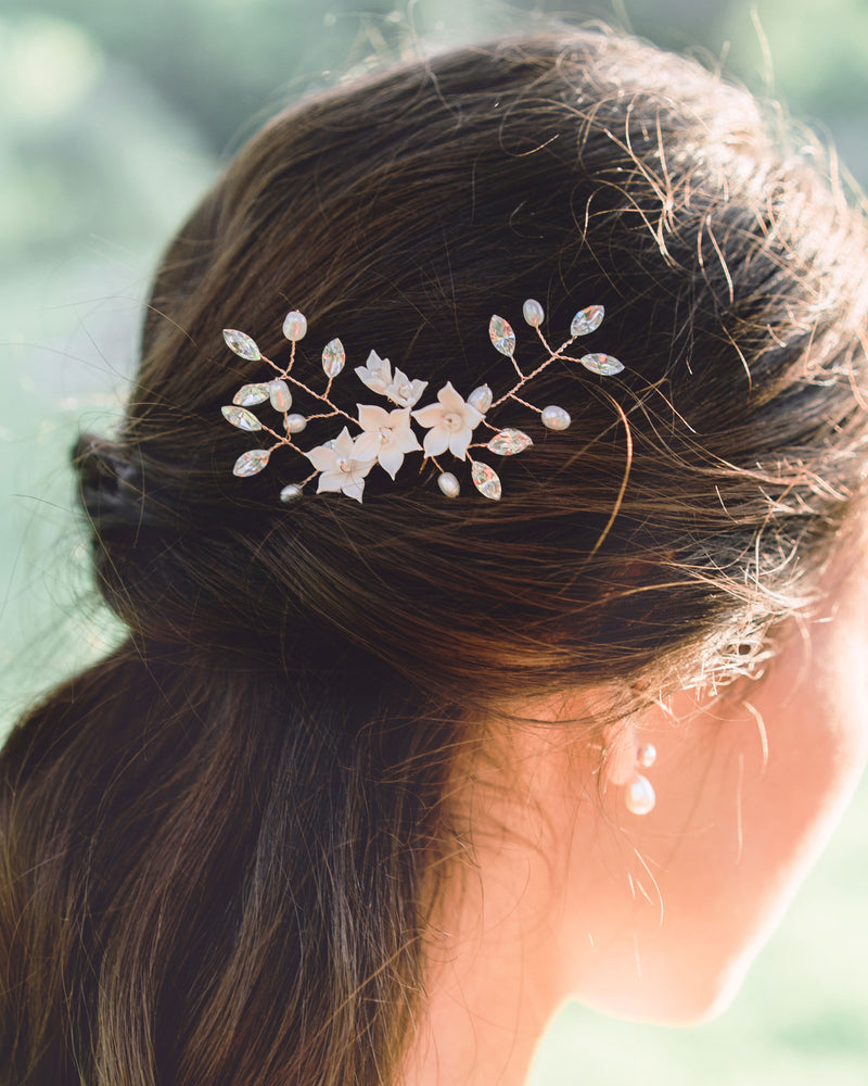Model wearing Belle Fleur rose gold hair pins with swarovski crystals and freshwater pearls in a half updo bridal hair