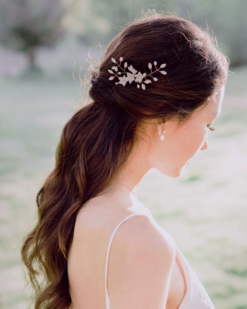 model wearing belle Fleur bridal hair pins with pearl drop earrings