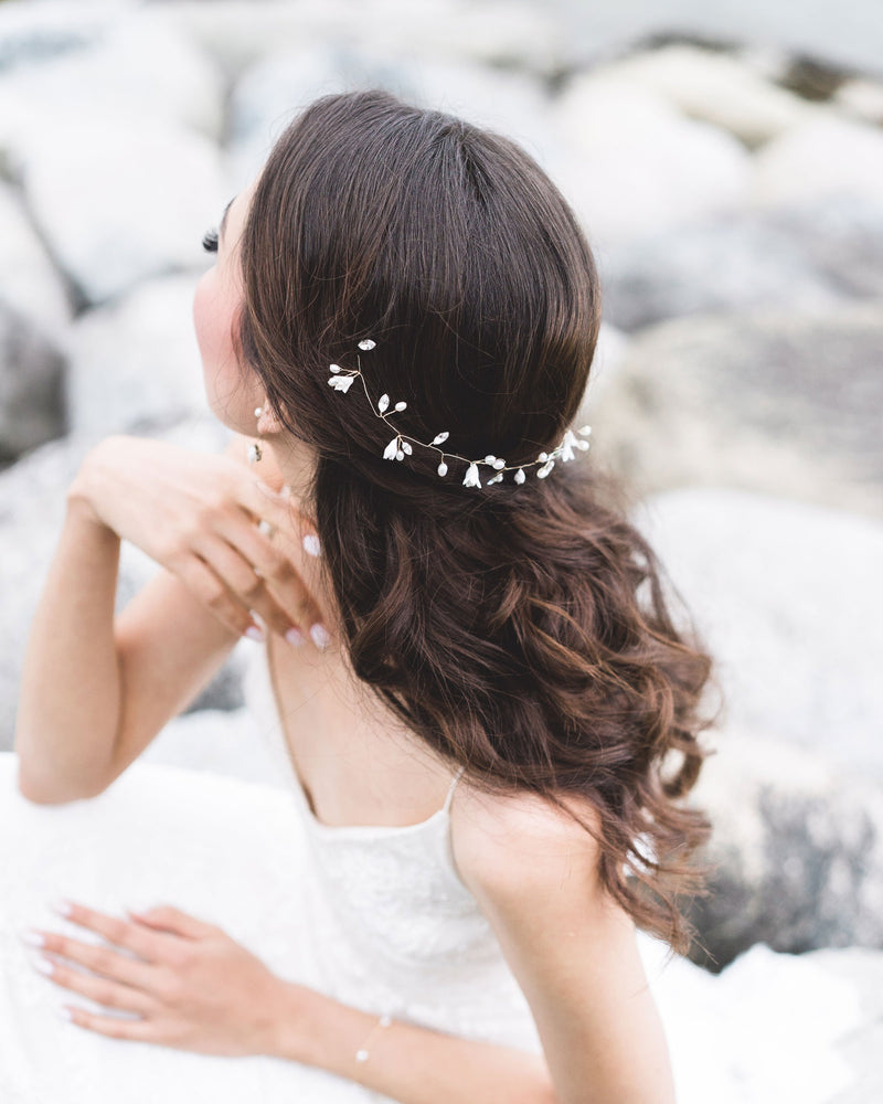 Delicate Belle Fleur Hair Vine of dainty flowers, pearls, and Swarovski crystals; styled to the back witha half up hairstyle.