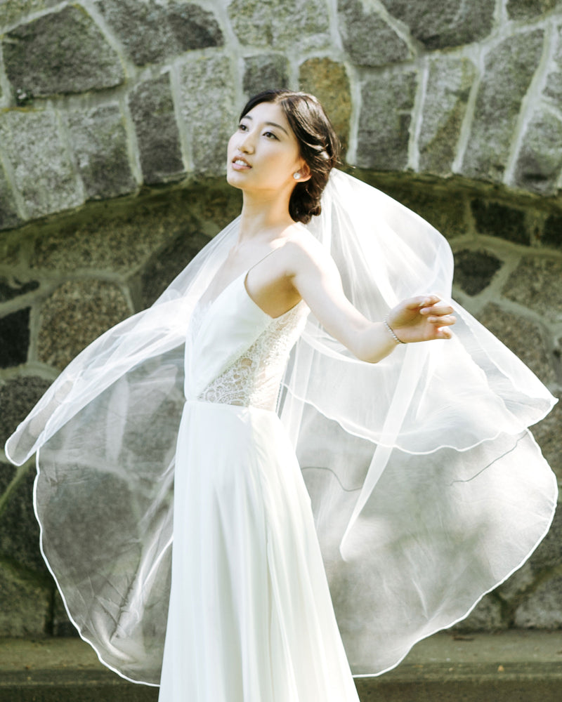 Veil shots of model wearing bridal veil with blusher