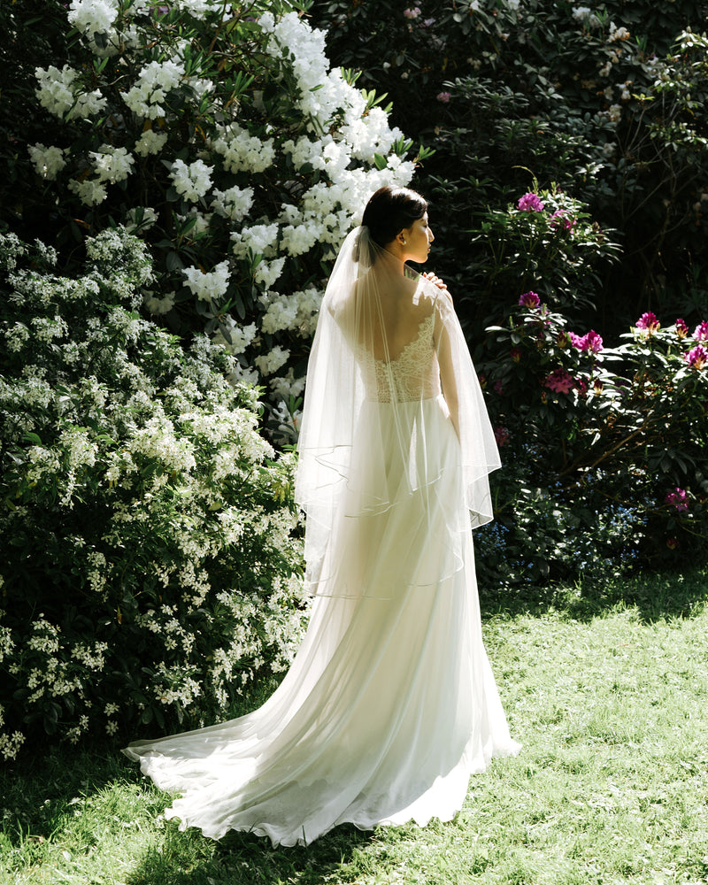 Calla bridal veil, model wearing short wedding veil