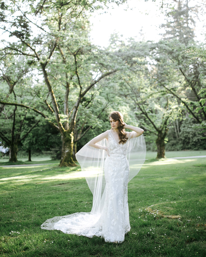 model wearing cascading leaves sheer bridal cape, alternatives to wearing a veil