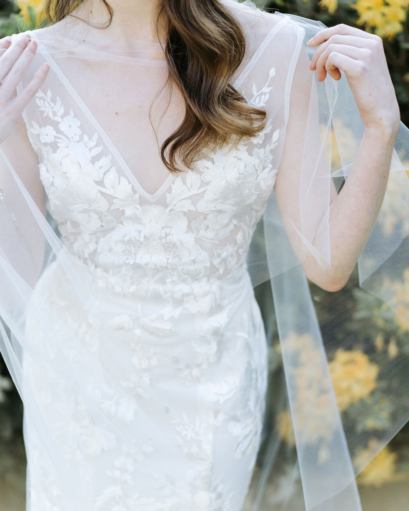 close up of cascading leaves wedding cape