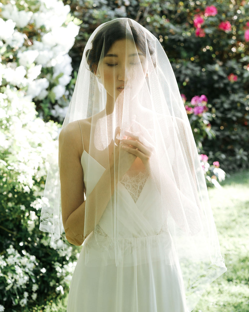 Model wearing Cascading Leaves circular blusher veil