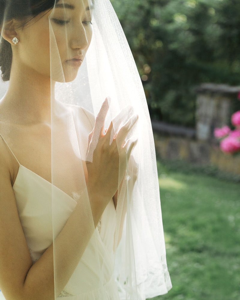 Veil shots model wearing cascading leaves bridal veil with blusher