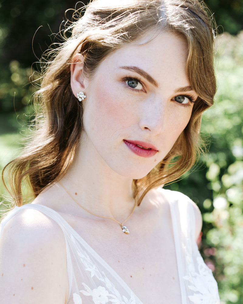 Model wearing gold celestial crystal stud earrings and necklace set with swarovski crystal