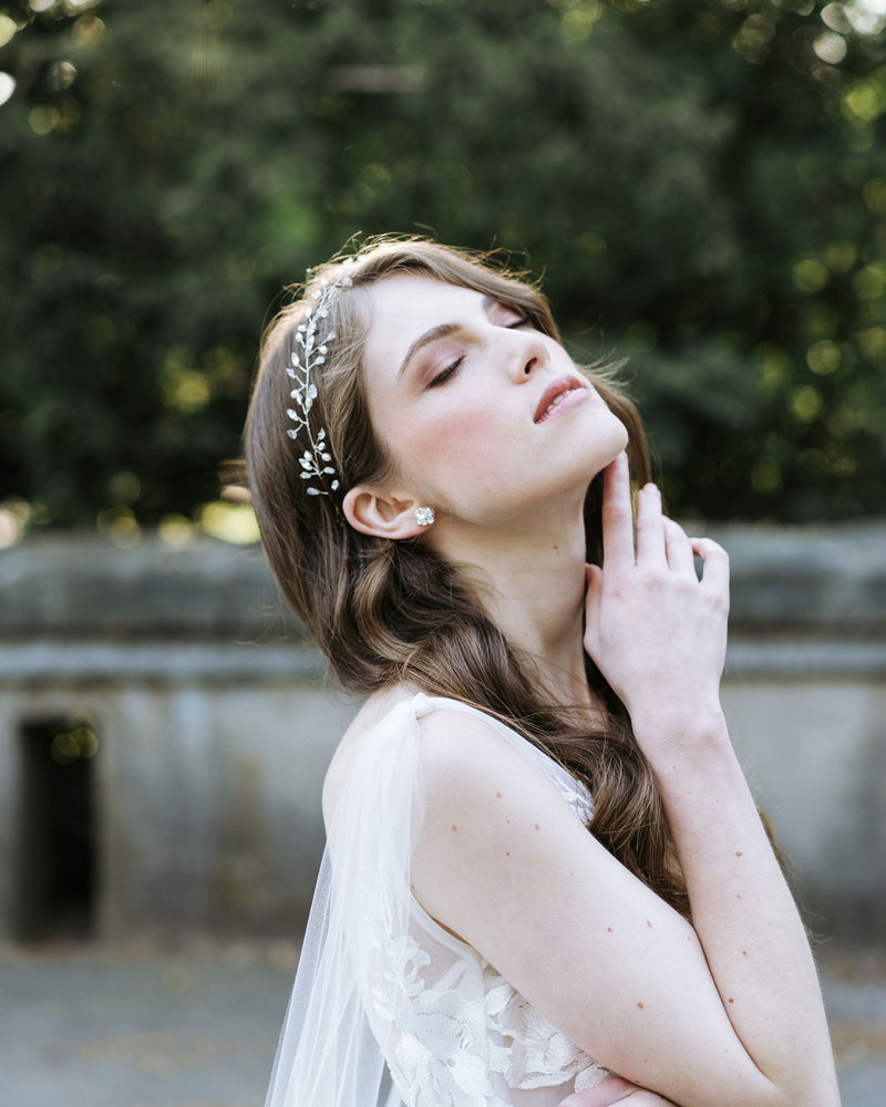 model wearing bridal stud earings celestial swarovski crystal stud earrings