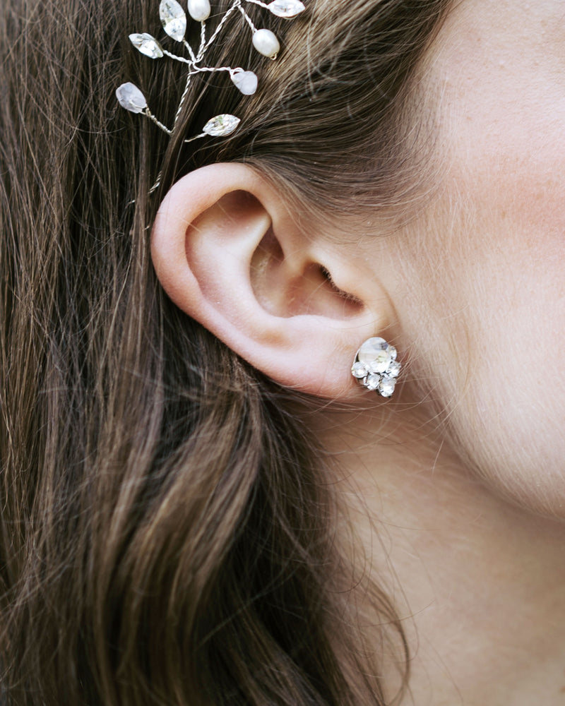 close up of model wearing celestial crystal stud earring bridal jewellery