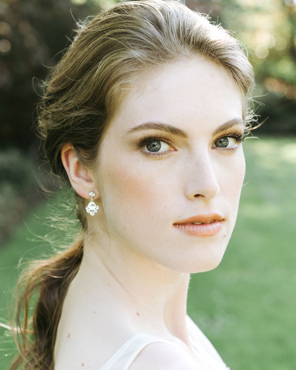 Model wearing celestial drop earrings in swarovski crystal and silver