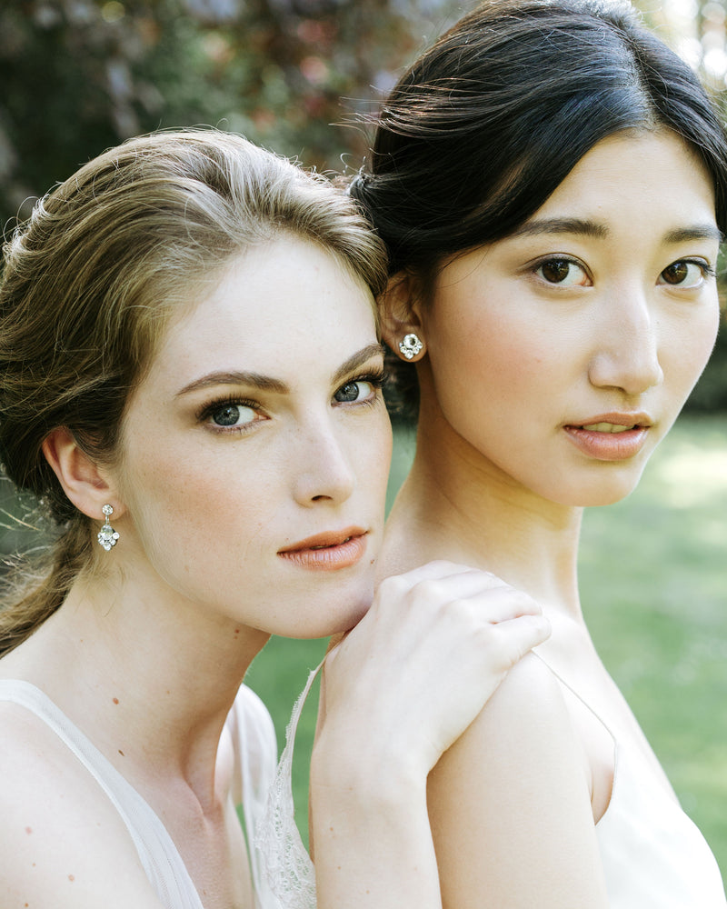 models wearring celestial drop earrings and celestial stud earrings made with swarovski crystals