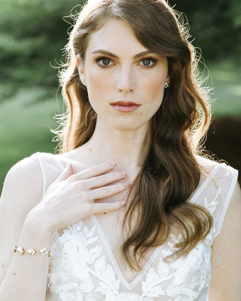 Model wearing celestial wedding pearl bracelet with swarovski crystal
