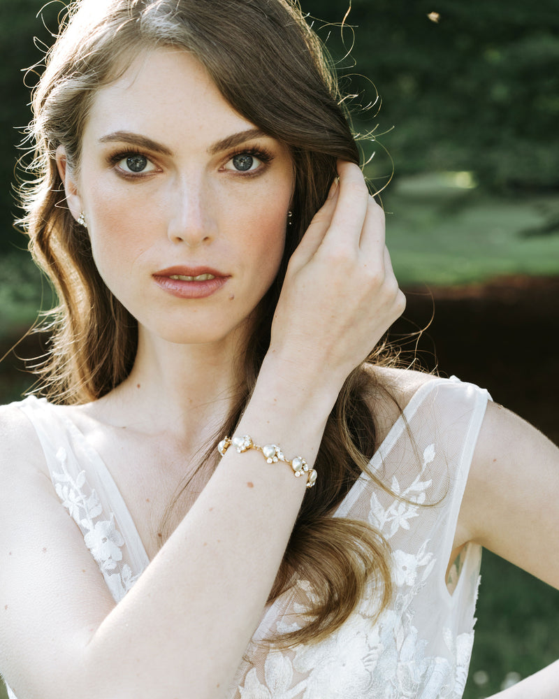 Model wearing celestial bridal pearl bracelet with swarovski crystal