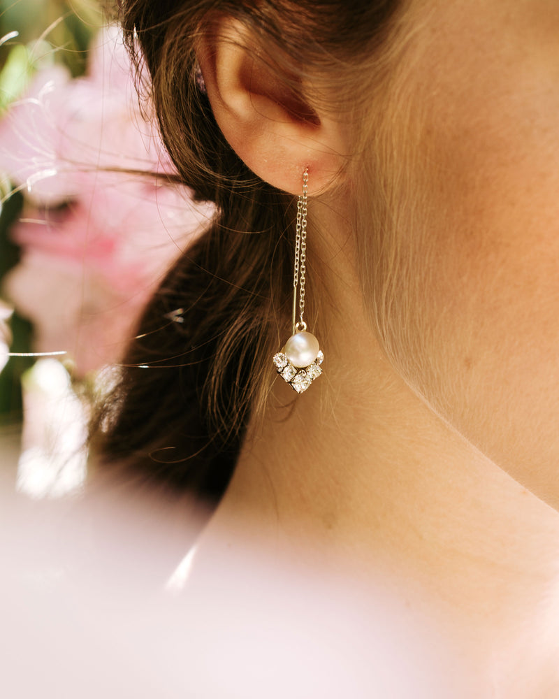 model wearing celestial pearl threader drop earrings with swarovski crystal and pearl