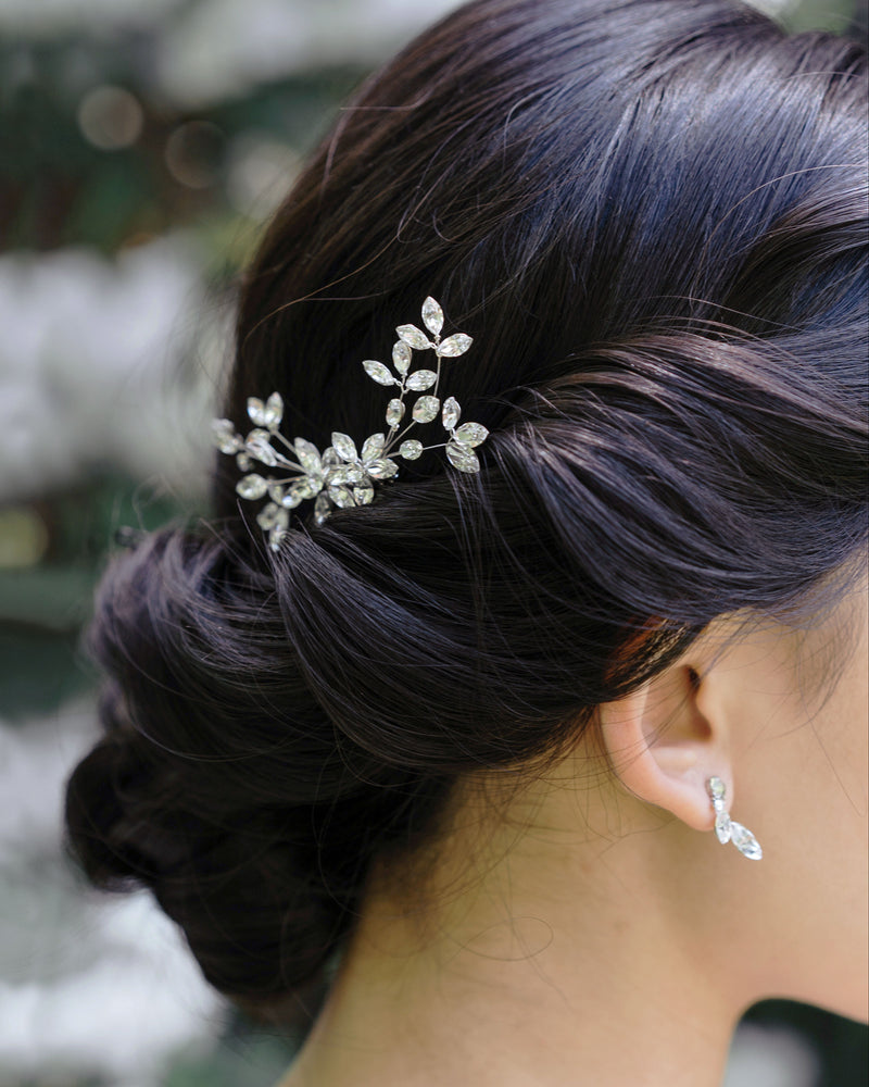 model wearing swarovski crystal blossoms petite delicate bridal comb in silver