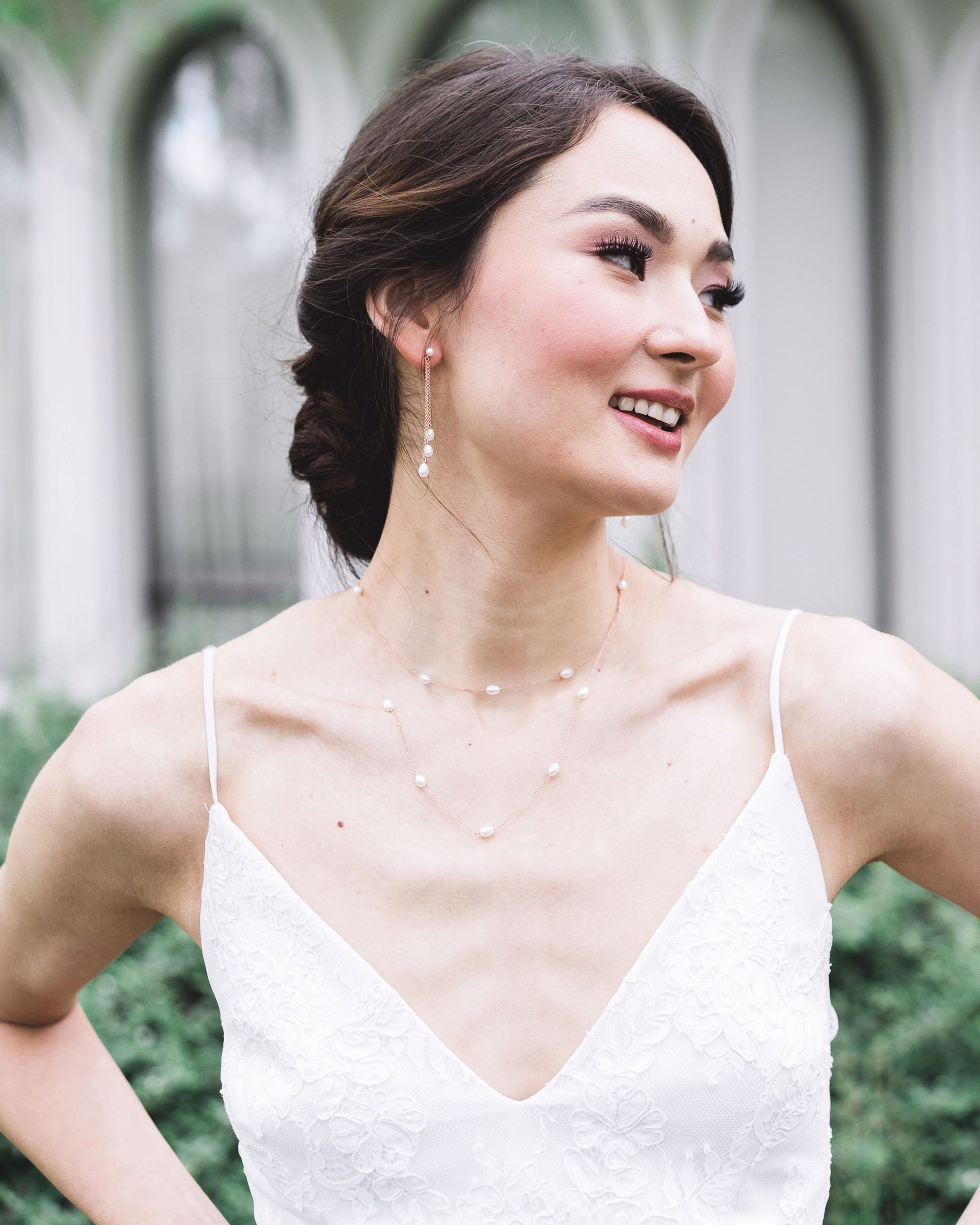model wearing the dainty pearl layered necklace in rose gold, paired with the matching dainty pearl trio earrings.