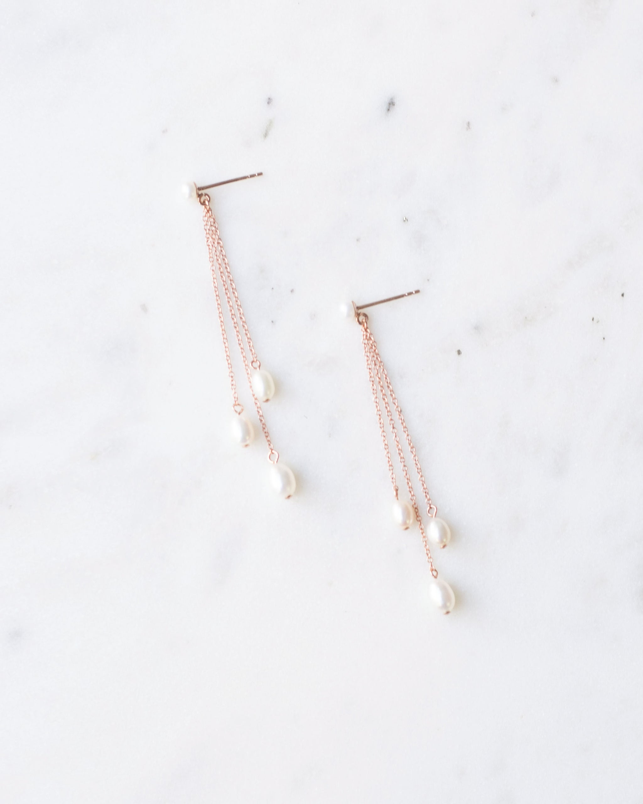 Flatlay of the Dainty Pearl Trio Earrings