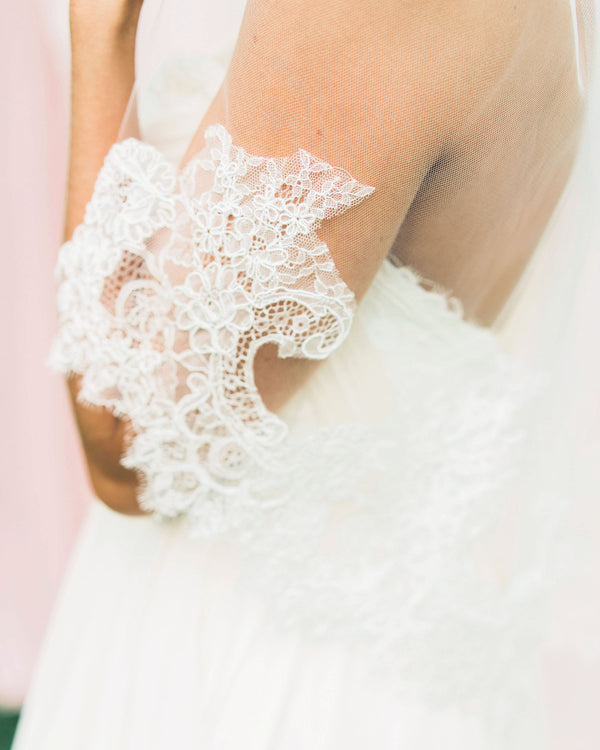Close up of short chantilly lace bridal veil