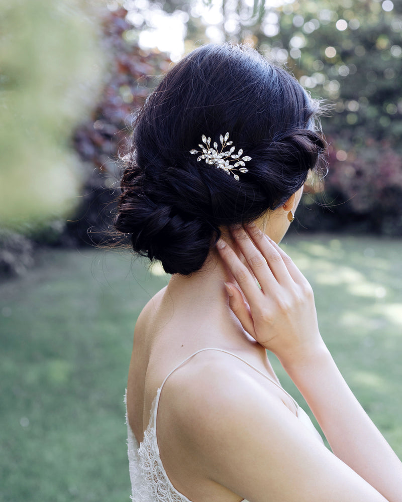 model wearing delicate swarovski crystal leafy hair comb in silver