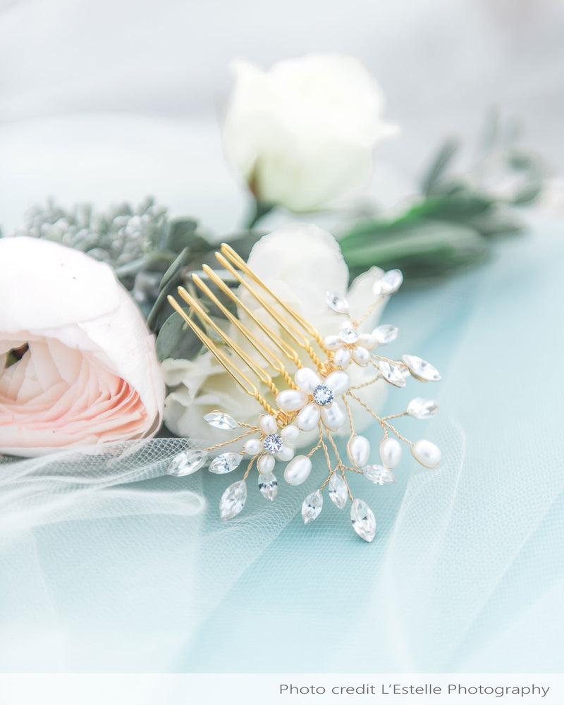 Delicate comb with freshwater pearl flowers and scattered Swarovski crystals.