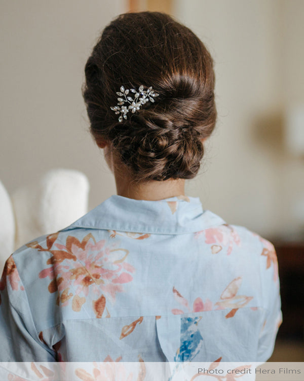 Real bride with low up do wearing pearl and crystal hair comb