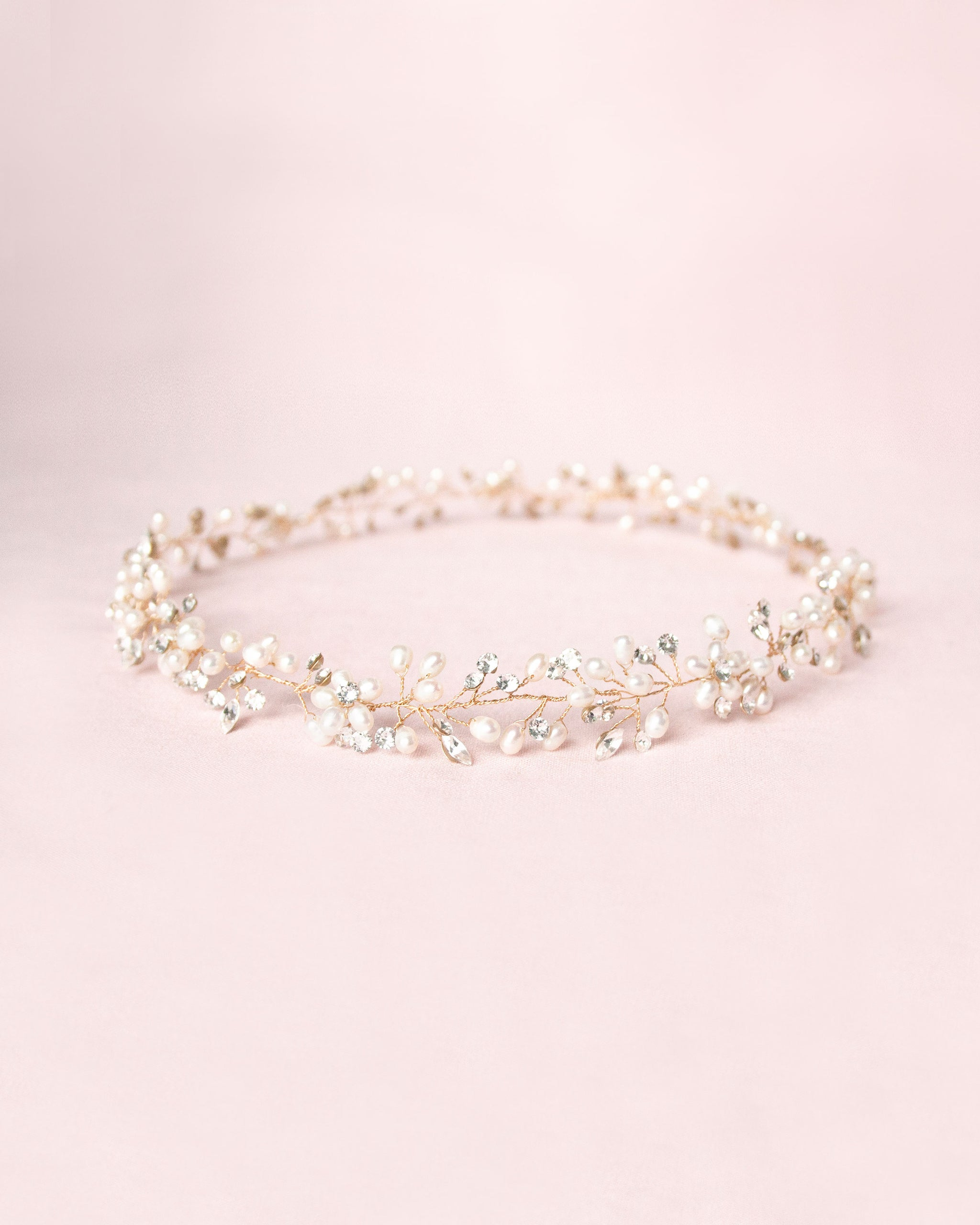 A romantic golden halo of Swarovski crystals and pearl clusters.