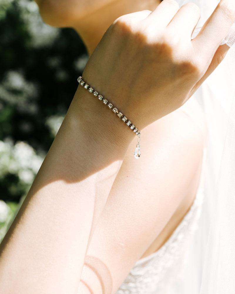 model wearing swarovski crystal cup chain tennis bracelet in silver