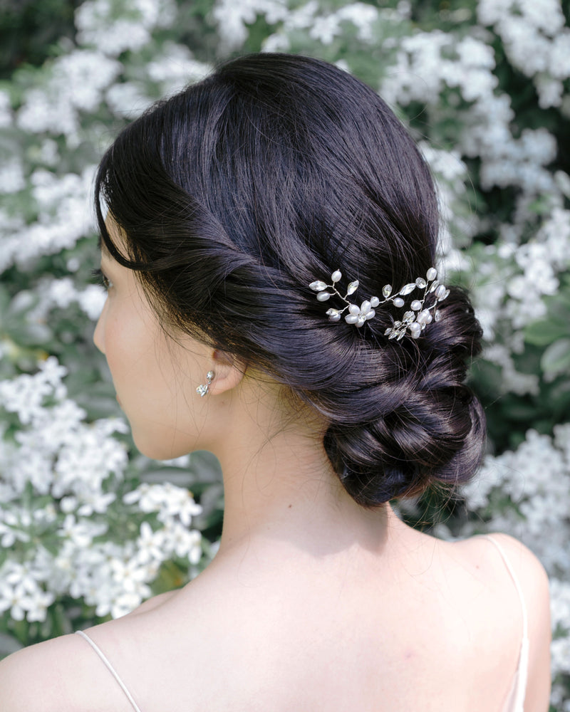 model wearing everthine hair pins in silver with swarovski crystal and freshwater pearls