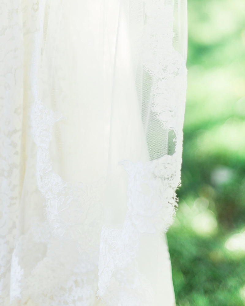Close up of alencon lace veil