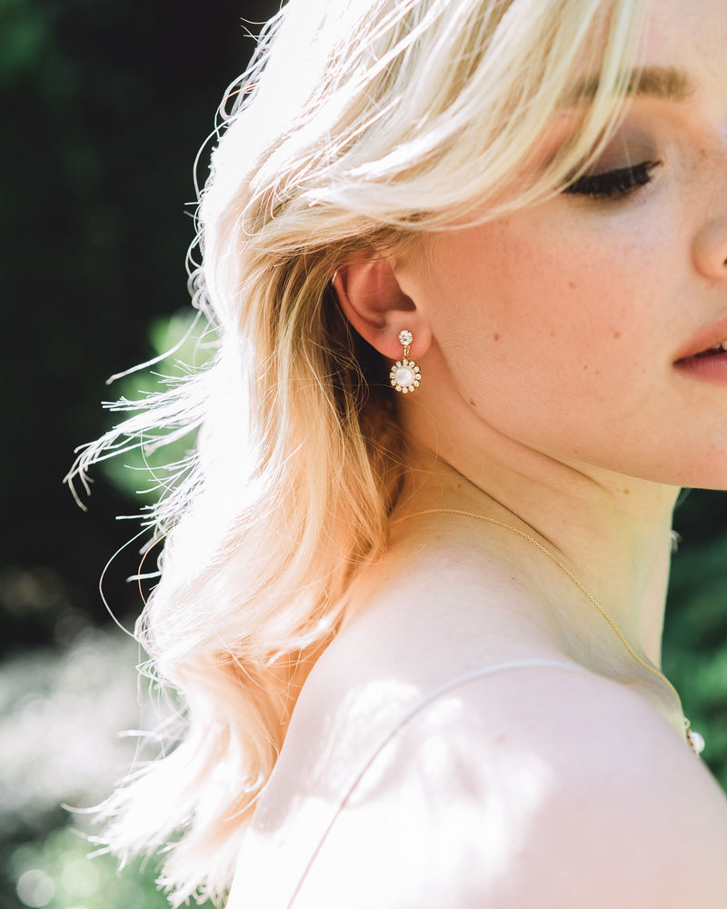 Model photo of the Halo Pearl Drop Bridal Earrings in gold with freshwater pearl.