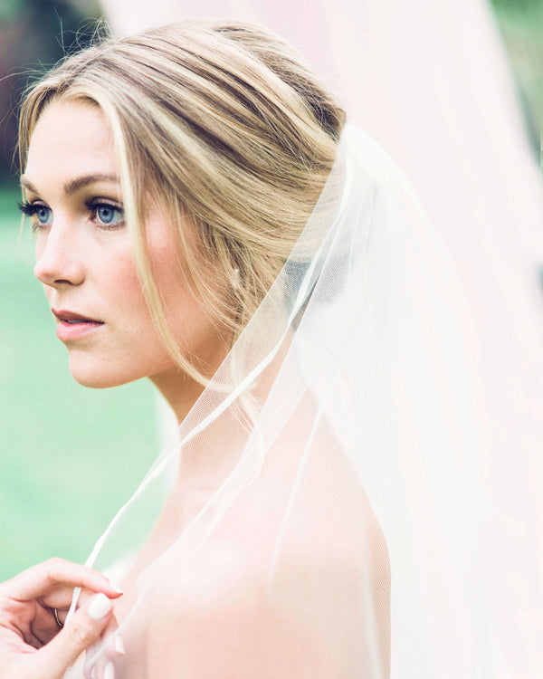 "Close up of model wearing veil with delicate 3/8"" satin ribbon edge"