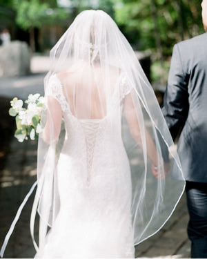 "Fingertip illusion tulle veil with hand-stitched delicate 3/8"" satin ribbon edge"