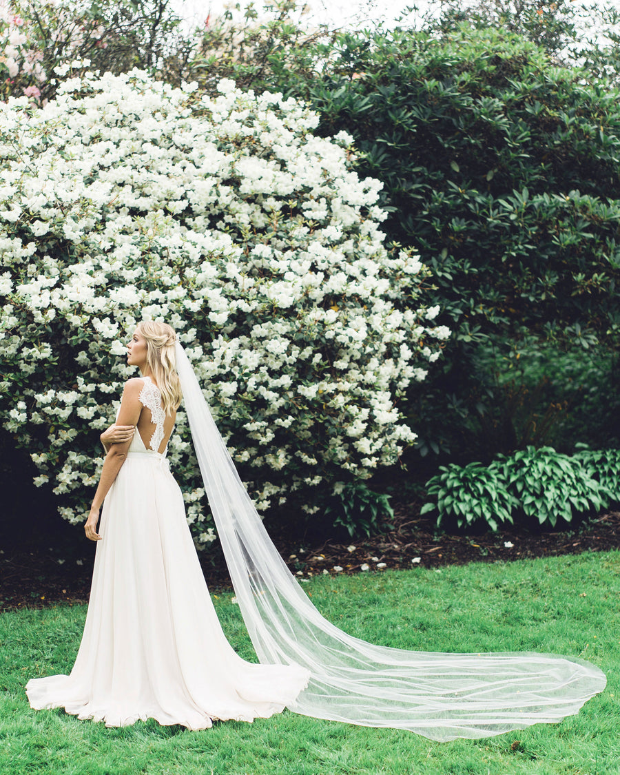 Cathedral single layer illusion tulle veil with a delicate hand cut edge.