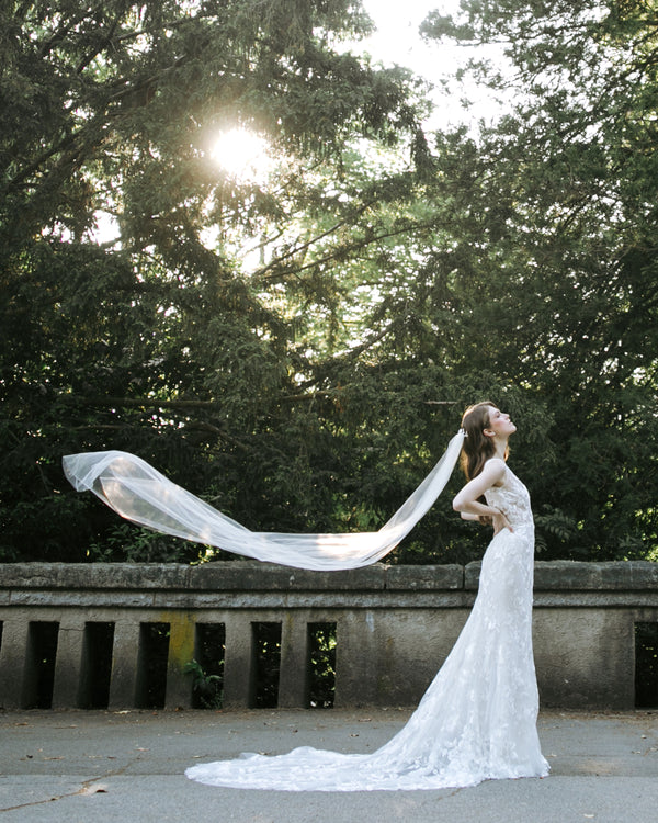 model wearing lily chapel length bridal veil