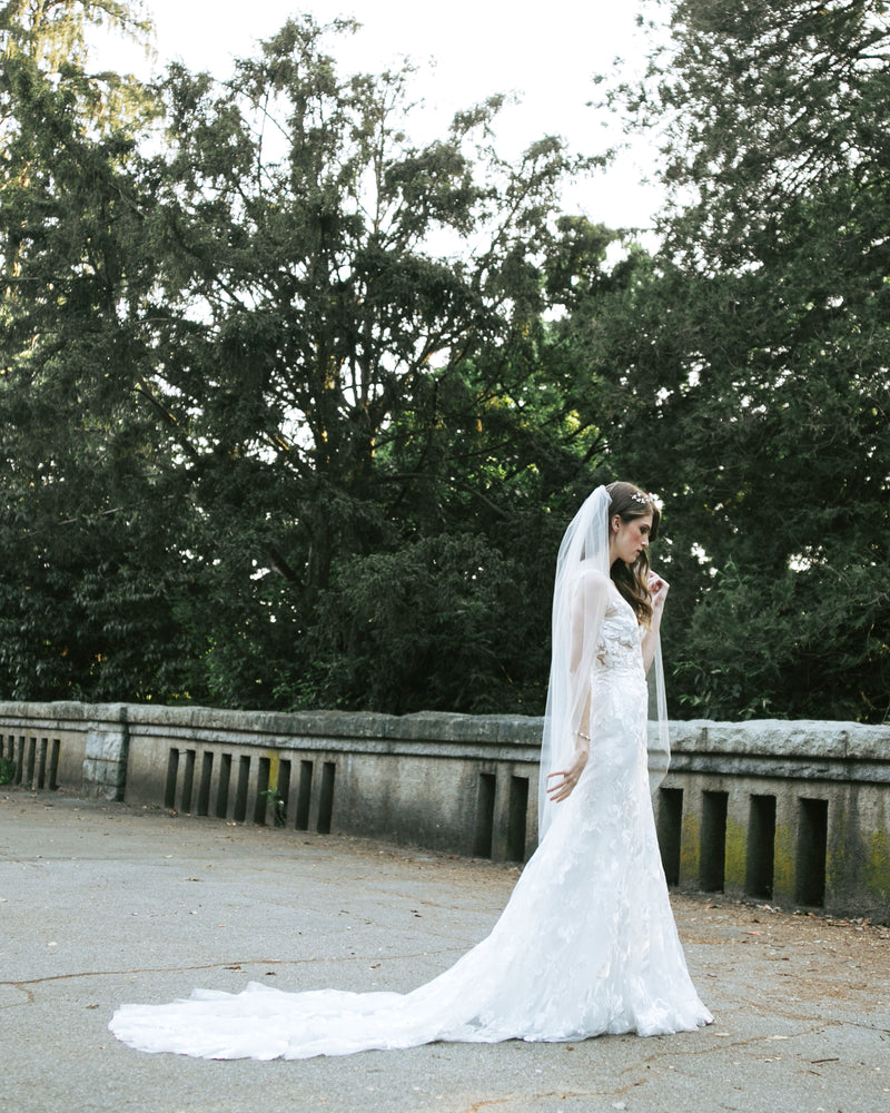 model wearing lily short plain bridal veil