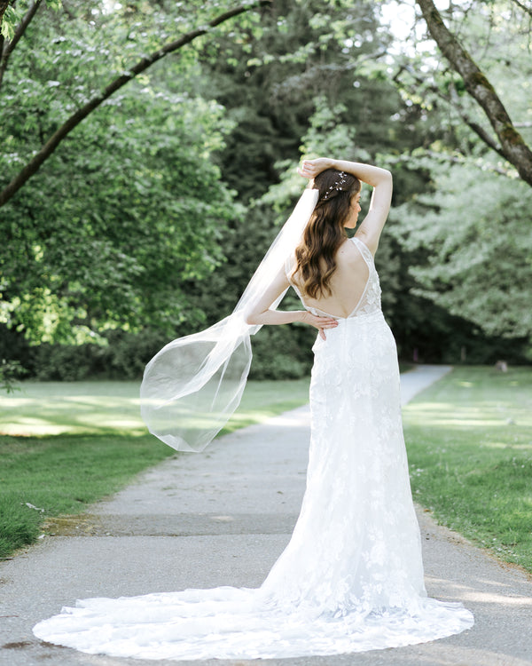 model wearing lily waltz length wedding veil