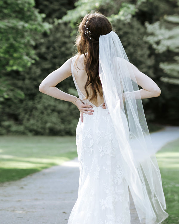 model wearing lily waltz length plain wedding veil