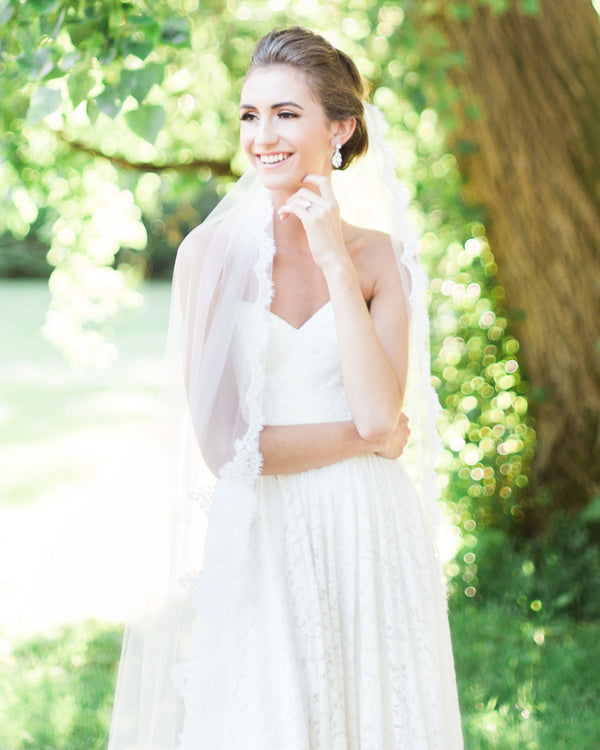 model wearing Magnolia chapel length lace wedding veil
