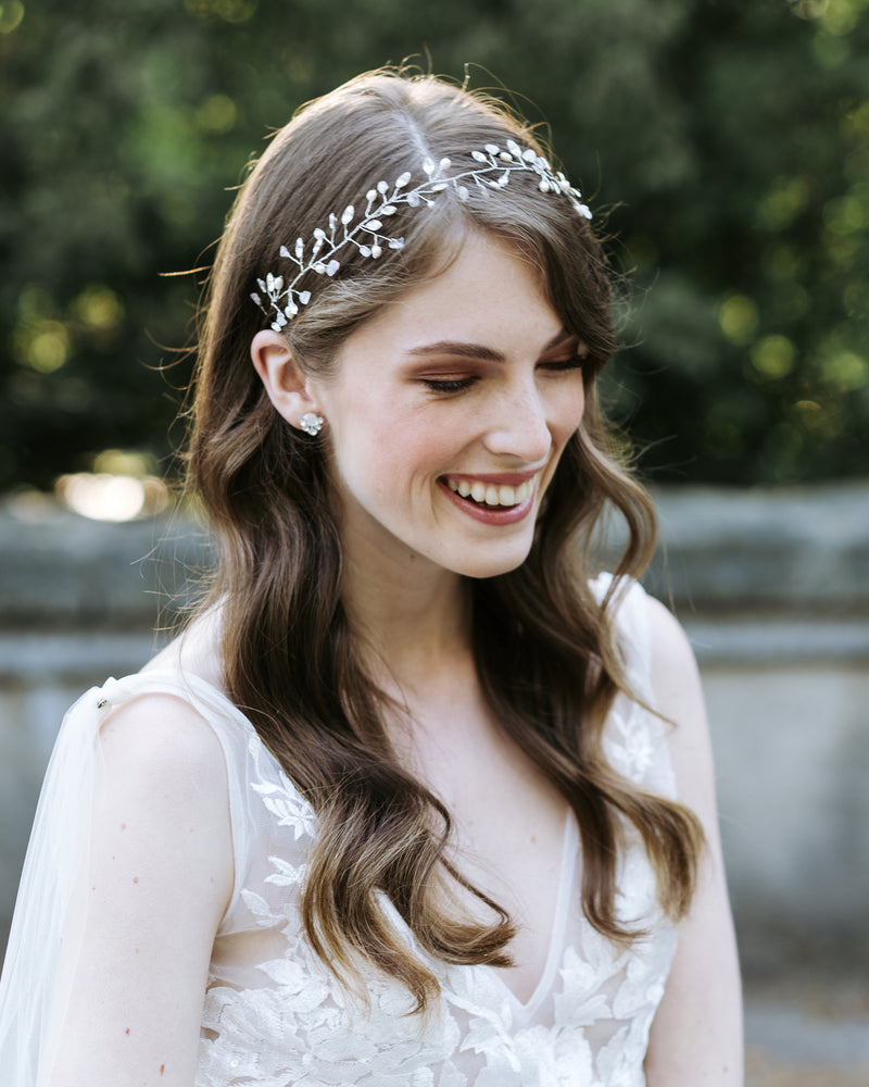 Model wearing Moonflower wedding hair vine in silver with rose quarts and swarovski crystals