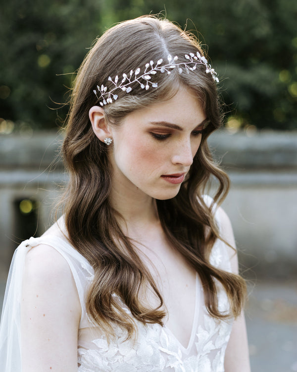 Model wearing Moonflower hair vine in silver with rose quarts and swarovski crystals