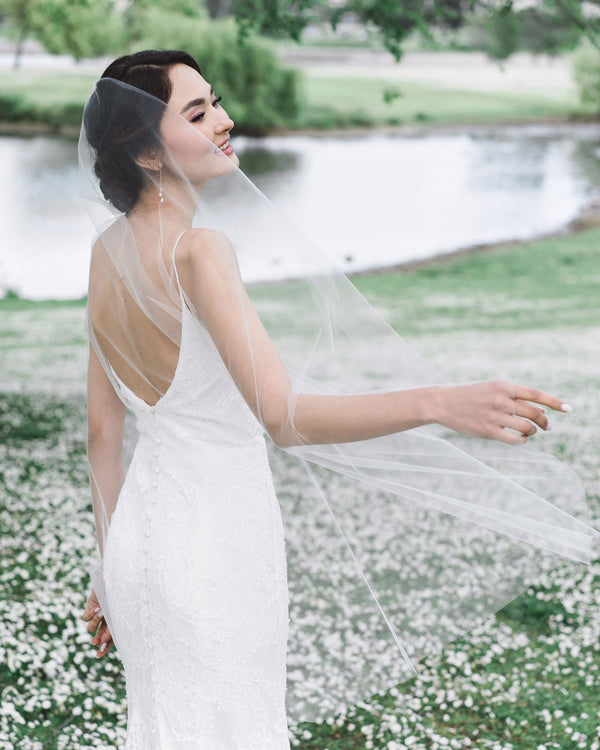 model wearing petal fingertip bridal veil