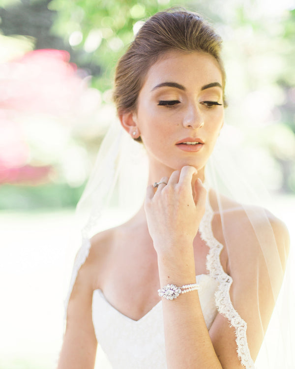 model wearing petite crystal brooch pearl bracelet with swarovski crystals