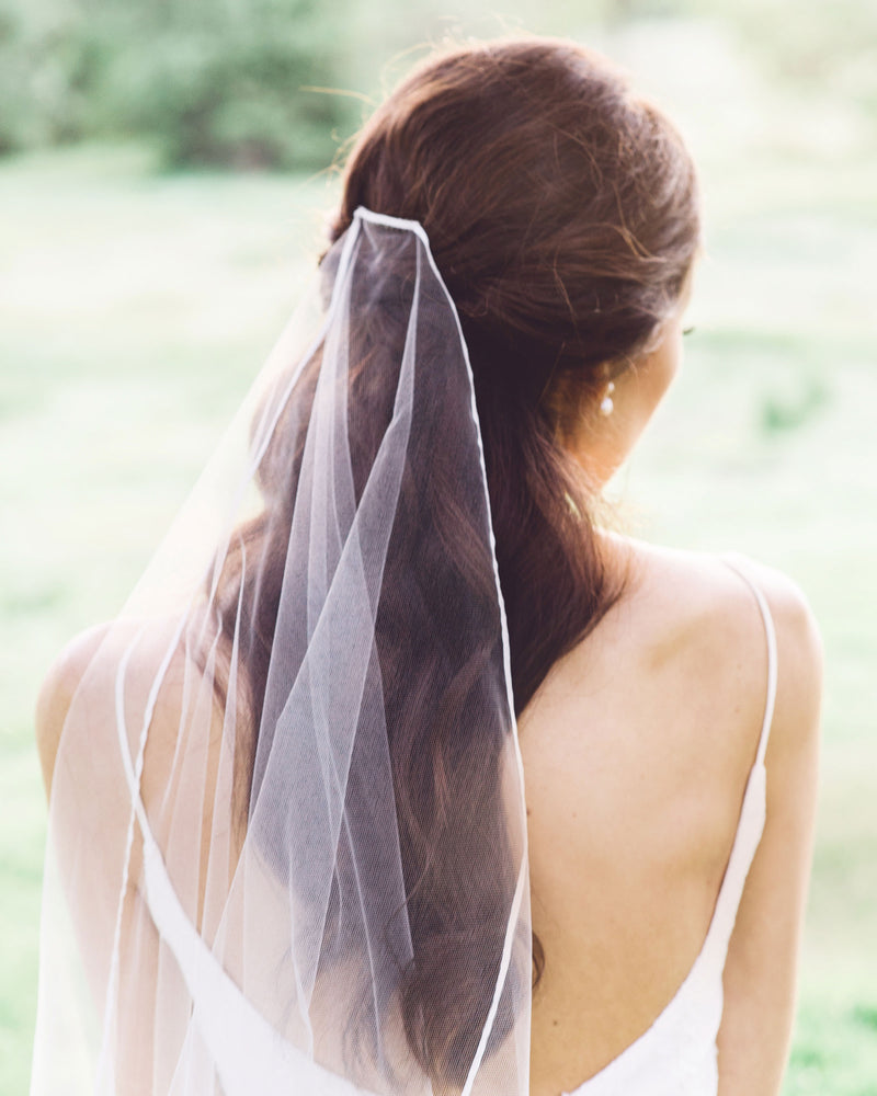 model wearing primrose ribbon edge bridal veil