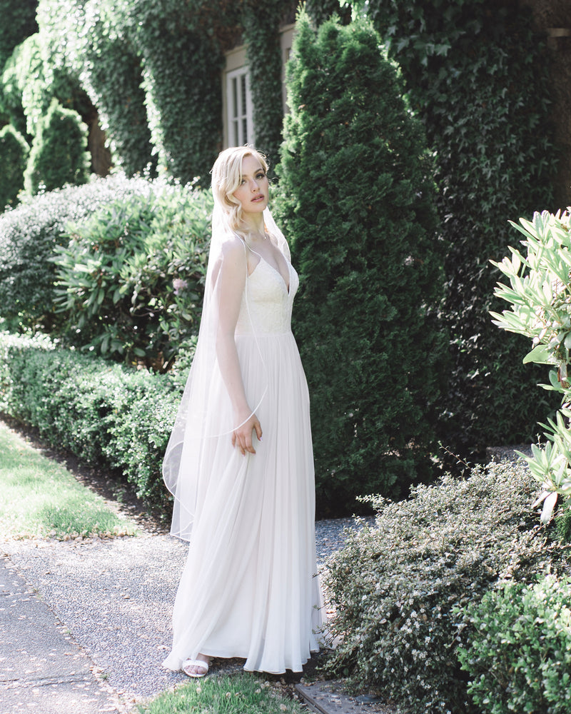 model wearing primrose waltz length bridal veil
