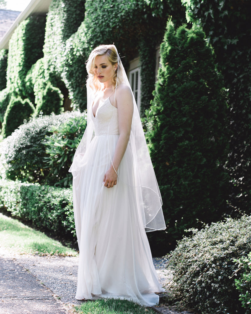 model wearing primrose waltz length veil
