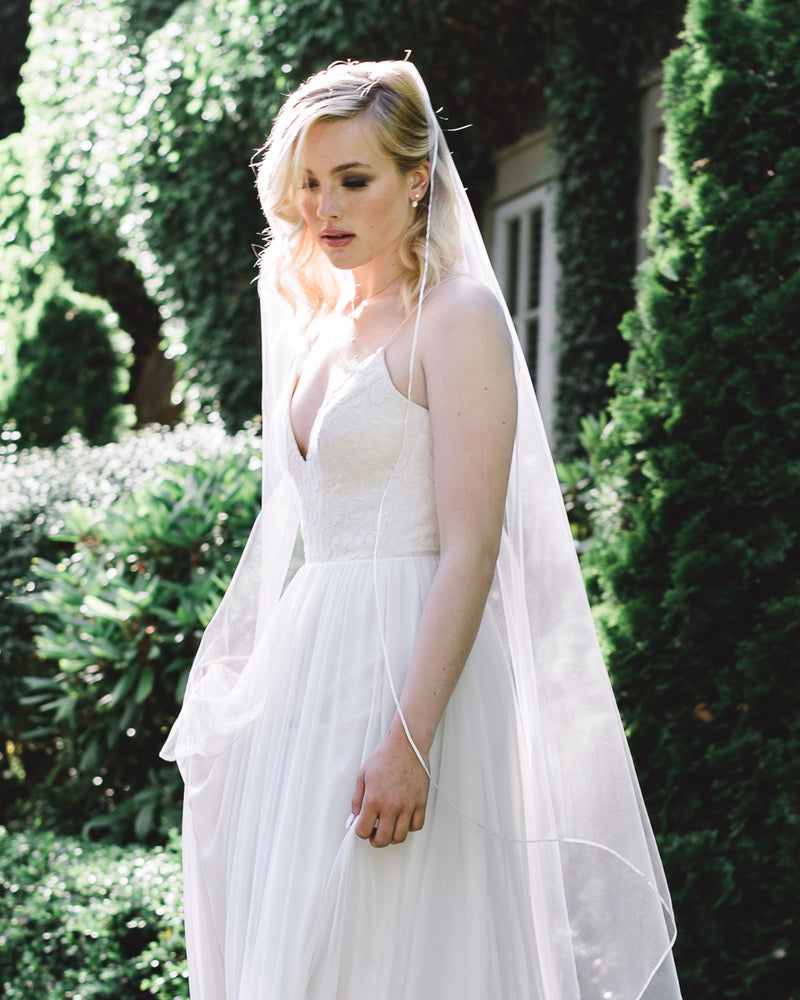 model wearing primrose waltz length wedding veil