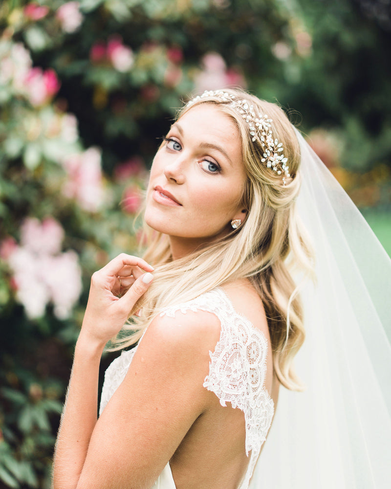 Model wearing Reverie rose gold bridal halo with swarovski crystals and freshwater pearls