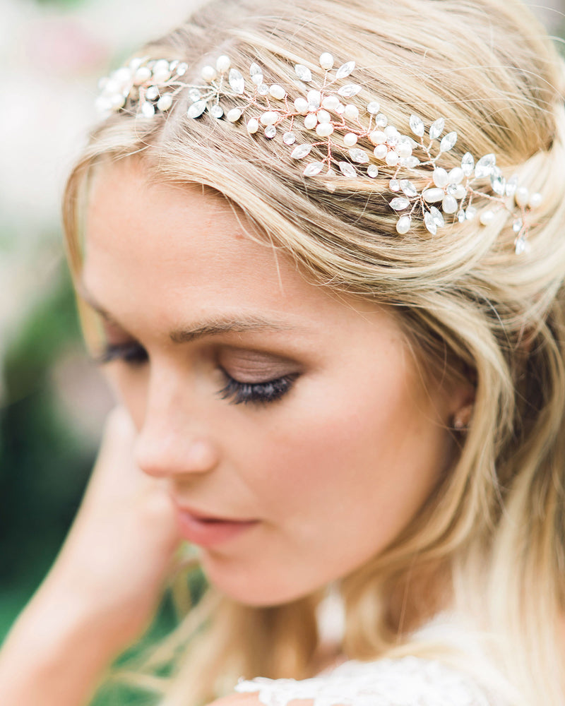 Model wearing Reverie rose gold wedding halo with swarovski crystals and freshwater pearls