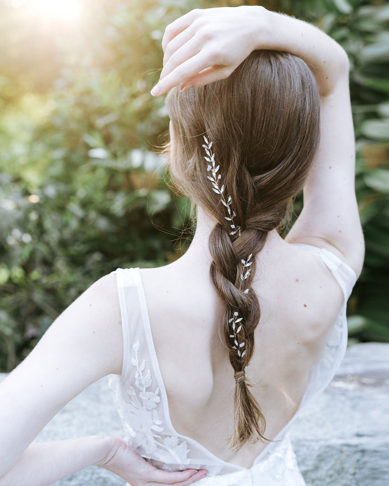 model wearing Sea Mist Moonstone and Rose gold braided hair vine