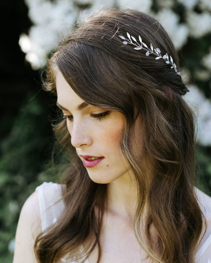 Model wearing seamist bridal hair comb in rose quartz and silver with swarovski crystals